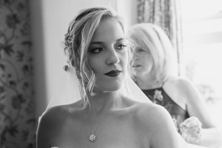 portrait of a bride final stage of wedding preparation. West midlands wedding photographer
