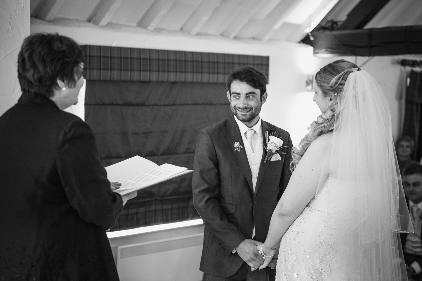 the wedding ceremony at windmill village hotel photographer by wedding photographer from west midlands coventry