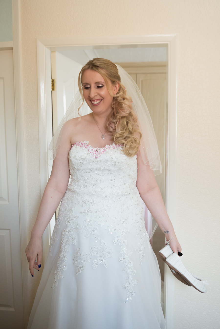 the bride ready for the wedding ceremony by coventry wedding photographer