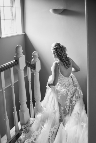 walking down the stairs by mk wedding photography